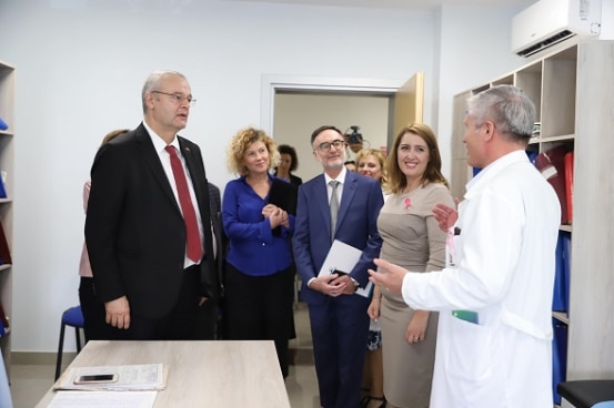 Swiss Ambassador Adrian Maître and Albania's Minister of Health Ogerta Manastirlliu visiting the renovated health centre in Lushnje