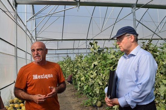 Swiss Ambassador Adrian Maître (right) meeting agribusiness representatives during field visit in Lushnje, 19.06.2019.