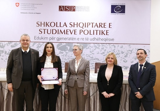 Swiss Ambassador in Albania Adrian Maître (left) handing out certificates to graduates of the Academy of Political Studies