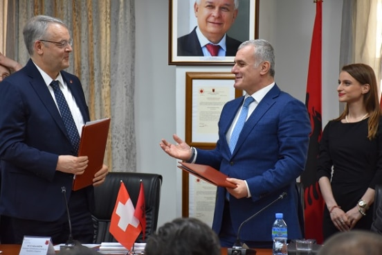 Swiss Ambassador in Albania Adrian Maître (left) after signing agreement on new assistance with the Head of Albania's Supreme State Audit Bujar Leskaj