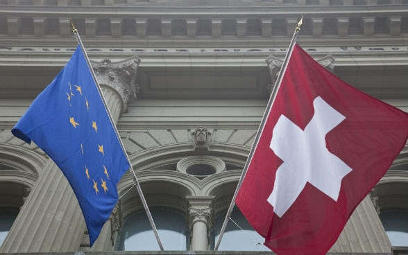 The Swiss and the EU-flag at the Parliament Building in Bern