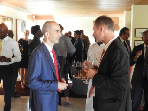Ambassador Stalder (right) interacting with some Swiss business owners