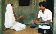 A man and a woman having a discussion in a working group on gender issues in Bangladesh