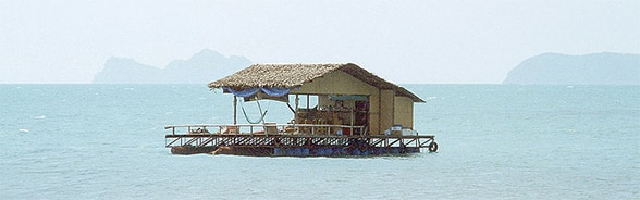 Image of a house floating on the sea