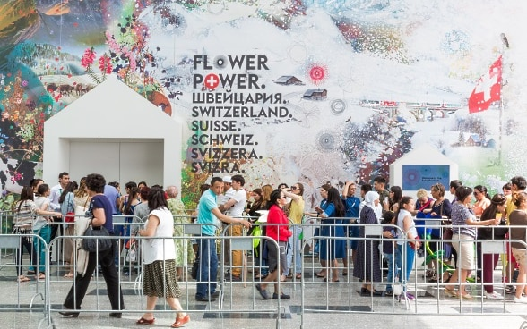 Visitors waiting at the entrance of the Swiss pavilion in Astana.