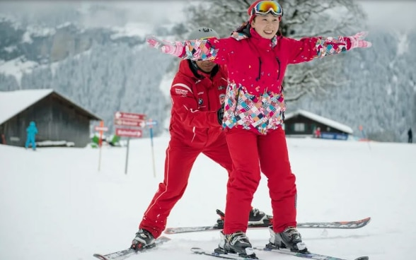 A Chinese visitor with her ski instructor.