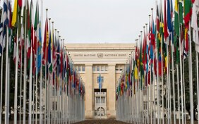 Image of the flags of the United Nations member states flying in front of the Palais des Nations in Geneva in 2014