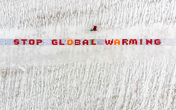 A long strip, one metre by 50 metres, laid out on the Aletsch glacier to form the message 'Stop global warming', made up of more than 2,500 postcards drawn and written on by children and young people.