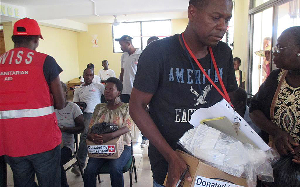 Haitians are being given boxes of hygiene products.