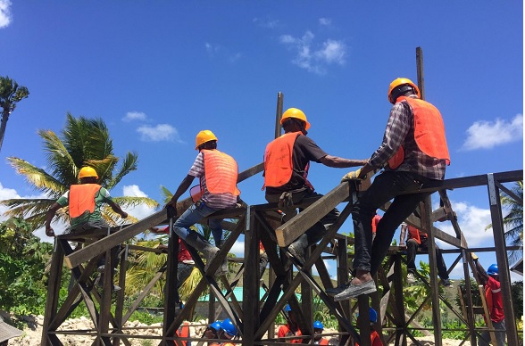 Workers learn how to build stable houses in cyclone-affected Southwestern Haiti.