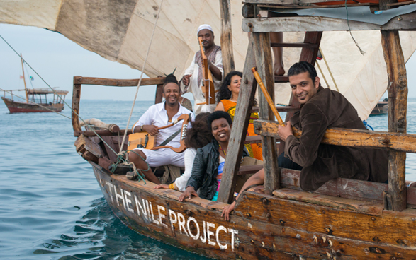 Nile Project musicians on a boat.