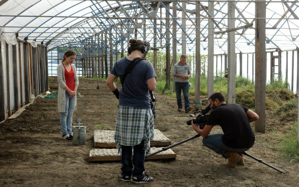 The photo shows preparations for the scene in which Medea waters tomato seedlings.
