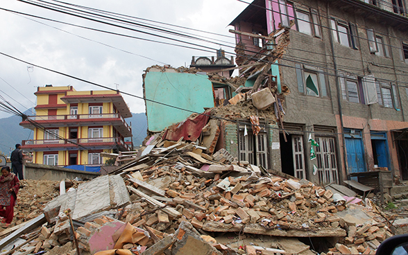 Rubble in front of a house destroyed by the earthquake in Gorkha (Nepal).
