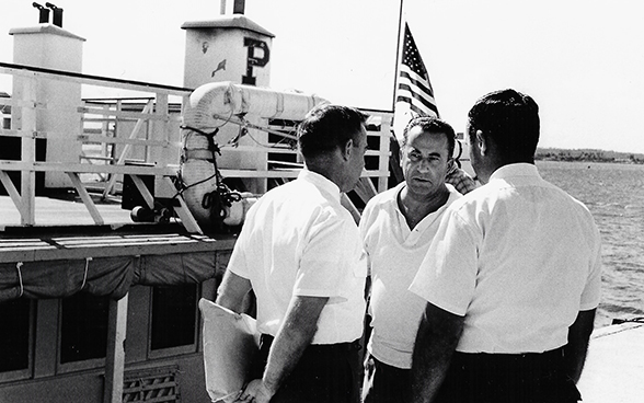 Emil A. Stadelhofer with US immigration officials in the port of Camarioca in October 1965.